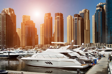Sea bay with yachts at sunset in Dubai Marina