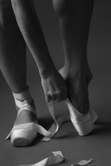 Putting pointe shoes on