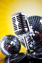 Retro microphone on sun grunge
