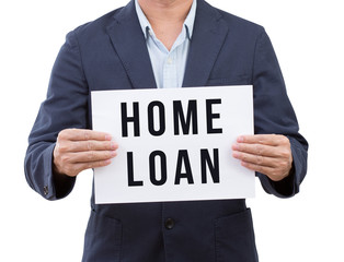 Business man hand holding home loan banner isolated on white bac