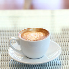 coffee on white table in cafe
