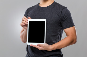 Man show with blank screen of digital tablet