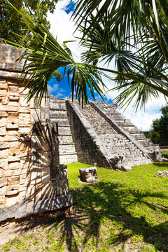 Wall, Chichen Itza monument, Mexico with palms