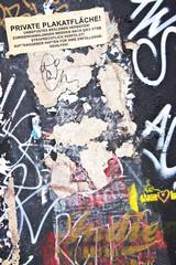 Post no bills wall with graffitis, Berlin, Germany