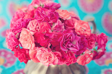 bright bouquet of a beautiful tea roses in a vase