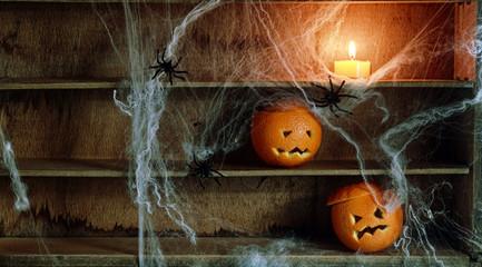Two Jack o Lanterns Carved from Oranges on Shelf