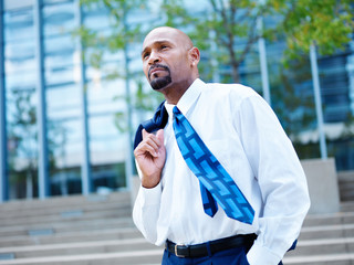 mature african businessman looking off in distance