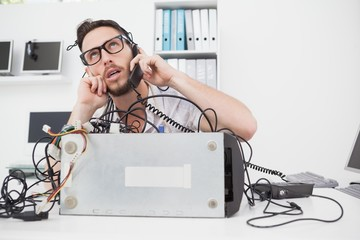 Annoyed computer engineer making a call