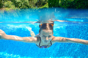 Kid swims in swimming pool, underwater and above view