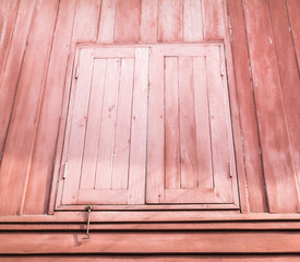 Old window with vintage wood wall