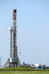 oil drilling rig with equipment on field