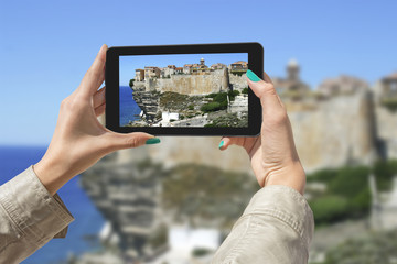 Photographing Bonifacio with tablet