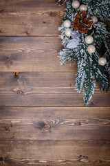 Christmas decorations on wooden background of aged boards.