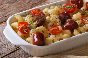 pasta baked with cheese, tomatoes and sausages horizontal