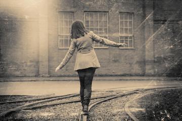 girl walking on the railway, retro stylized photo