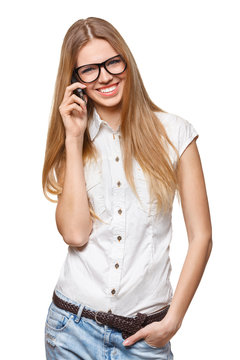 Happy smiling woman talking on the mobile phone on white