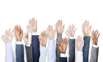 Group of Diverse Business People's Hands Raised