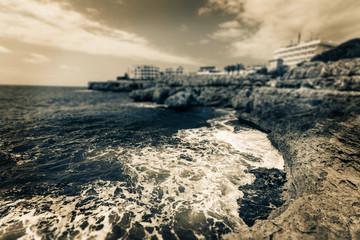 rocky ocean shore, black and white photo