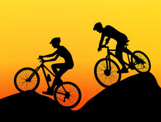 two cyclists silhouette extreme biking