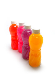 bottles of juice on a white background