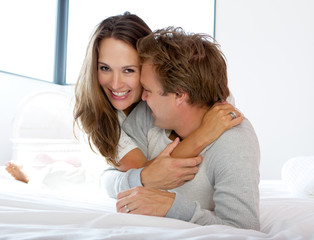 Cheerful couple smiling at home