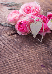Fresh roses on wooden background
