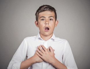 Man shocked surprised in disbelief hands on chest