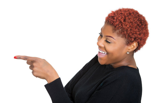 Happy, laughing woman, pointing finger at someone
