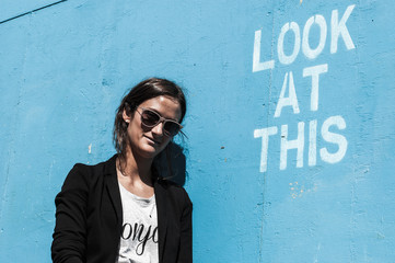 """Hipster model wearing sunglasses posing next to """"Look at This"""""""