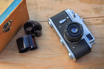 Old camera on wooden background