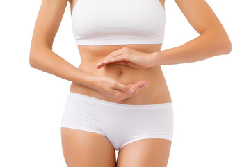 Healthy woman with hands around her stomach