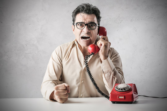 businessman arguing by phone