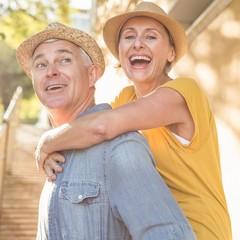 Happy mature couple having fun in the city