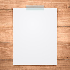 empty white paper sheet on wood background