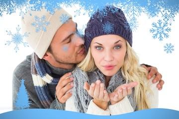 Composite image of attractive couple in winter fashion