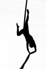 acrobatic woman dancer yoga on aerial silk, aerial contortion