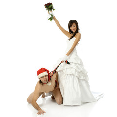Girl in a wedding dress holding a naked man for a tie