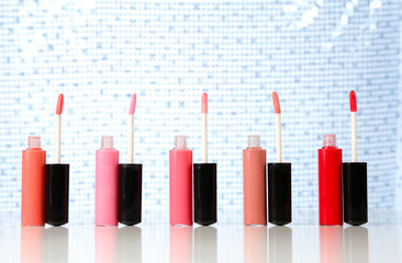 Beautiful lip glosses on bright background