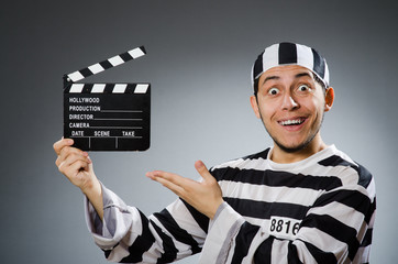 Inmate with movie clapper board
