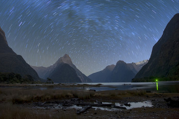 Milford sound at night with startrail, New Sealand