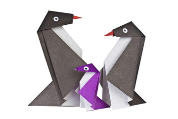 Origami. Paper figures of penguins