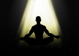 Silhouette of a man figure meditating under the light