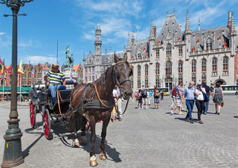 Wall Murals Bridges Bruges - The Carriage on the Grote Markt square