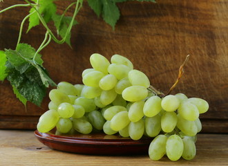 fresh organic green grapes on a wooden table