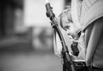 child is sitting in a carriage.
