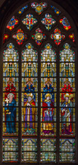 Bruges - Windowpane with the saints in the in st. Giles church