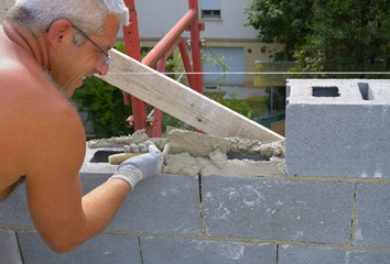 Mason performs an external masonry blocks concrete