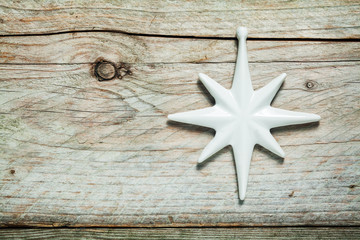 Pretty white Christmas star on old wood