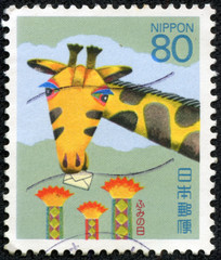 drawing of a giraffe with an envelope in the mouth