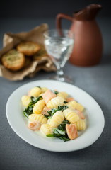 Italian gnocchi served with salmon and basil